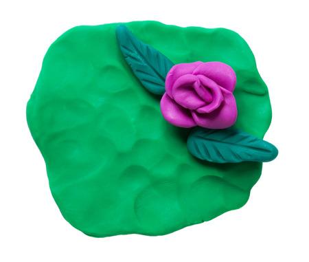 Plasticine rose isolated on white background photo
