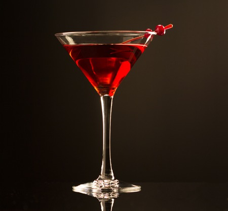 liquor glass: Cocktail drink on cranberries