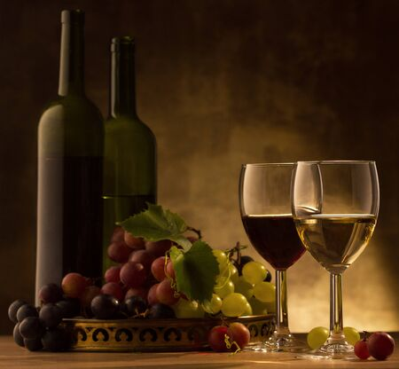 responsibly: Red and white wine glasses and grape