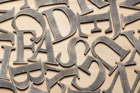 Wooden letters on wooden background Stock Photo