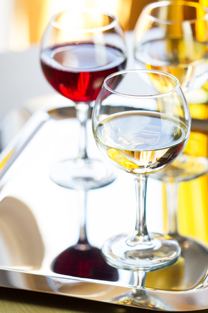 drink responsibly: Glasses of white and red wine