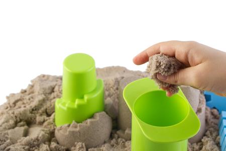 kinetic: Fun kinetic sand.Child building sand castle