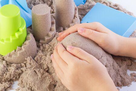 motility: Fun kinetic sand.Child building sand castle