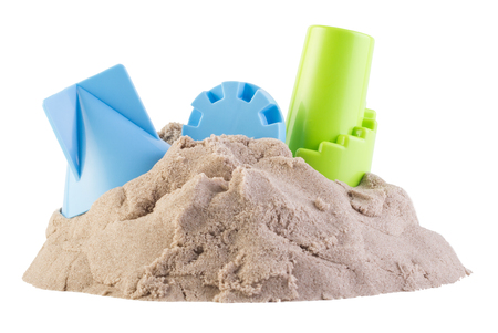 motility: Kinetic sand with child toys isolated on white background