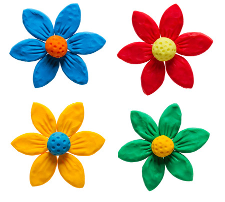 Colorful plasticine flowers isolated on white background