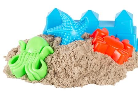motility: Sand with child toys isolated on white background Stock Photo