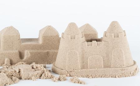 sandcastle: Sandcastle on white background Stock Photo