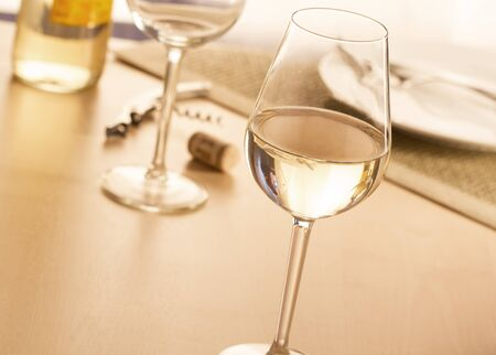 responsibly: Glass of white wine