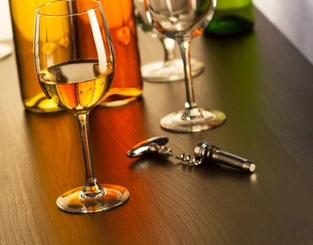 Glass of white wine on table