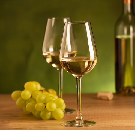 Two glasses of white wine and grape
