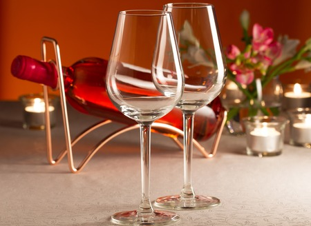 Two empty glass and bottle of rose wine
