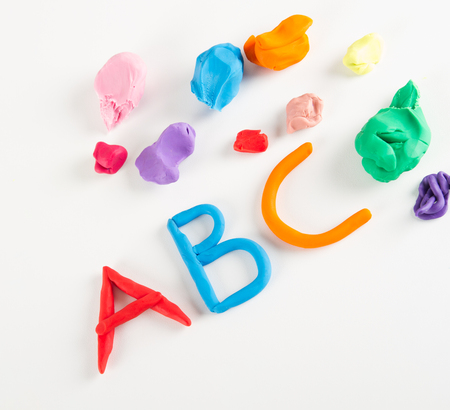 playdoh: Colorful plasticine letters on white Stock Photo