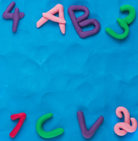 plasticine: Plasticine background.Letters and numbers Stock Photo