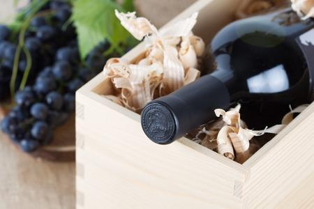 bordeau: Red wine bottle in wooden box