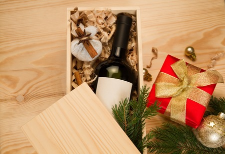 Red wine bottle and spices for mulled wine in wooden box Stock Photo