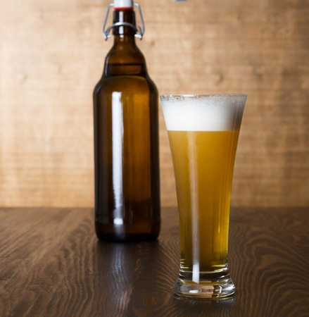 Craft beer glass on wooden table Stock Photo - 102958453