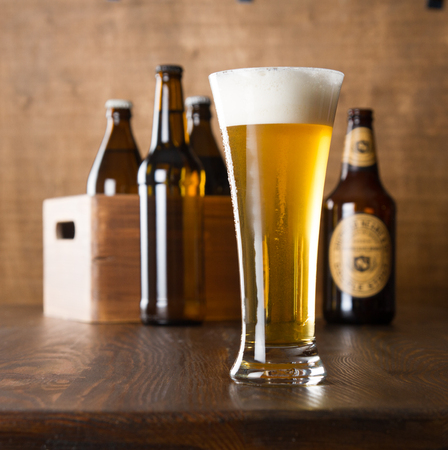 Craft beer glass on wooden table