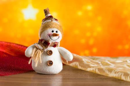 Christmas fairy snowman congratulates. Christmas background. Golden Star.