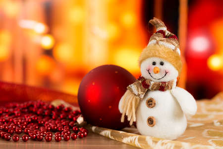 Snowman, red ball, golden balls and cones in Christmas composition. Stock Photo
