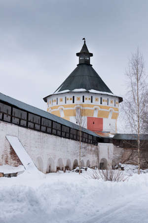 architecture monumental: Spaso-Priluckiy monastery in winter. View a gallery of monastery wall. Vologda tower. Vologda. Travel north Russia. Ancient architecture. Saviour Priluki Monastery in winter frosty day