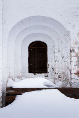 spassky: Spaso-Priluckiy monastery in winter. Spassky Cathedral. Ancient window portal. Detail of facade. Vologda. Travel north Russia. Ancient architecture. Saviour Priluki Monastery in winter frosty day Stock Photo