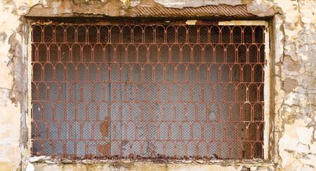 lattice window: Window with lattice in old building. Old window with a lattice. Arches lattice