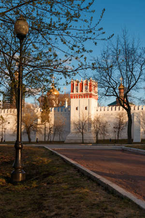 Novodevichy Convent at springtime, Moscow, Russia. Walls of the monastery. Sunset sun