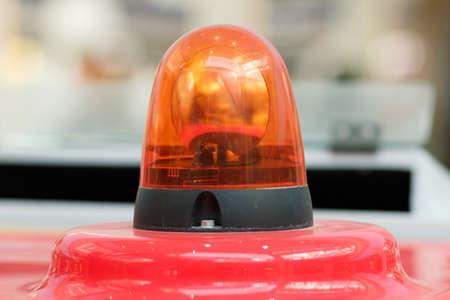 Light signal on special equipment. Rotating beacon machines. Orange Light siren.