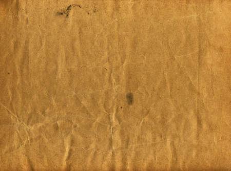 古い紙の質感。段ボール。スタイルの背景を抽象化します。テクスチャは、ペーパーの古い黄ばみ。ベージュの紙のテクスチャです。