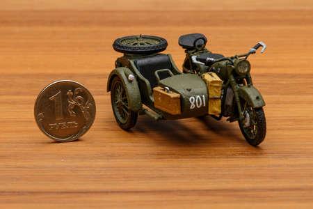 Soviet motorcycle with sidecar. Handmade miniature plastic model.