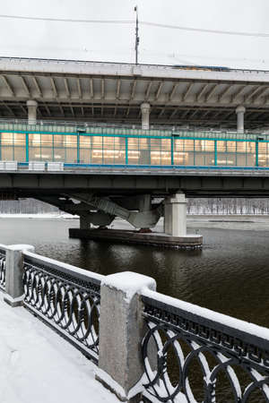 Metro bridge across the Moscow River. View from the snow-covered Luzhnetskaya embankment on the Vorobyovy Gory and the Andreevskaya embankment. The winter city landscape. Russia. Sparrow hills.