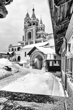 Savvino-Storozhevsky monastery in Zvenigorod in winter day. Moscow region. Architecture of the ancient Russian monastery. Black and white photograph of ancient Russian religious architecture.