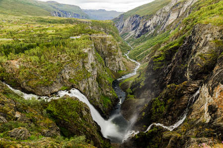 Beautiful view of the Voringsfossen waterfall. Bjoreio river . National park Hardangervidda, Eidfjord, Norway. Summer landscape in the mountains with a waterfalls. Travel around Norway. Picturesque mountain landscape with waterfalls. 版權商用圖片