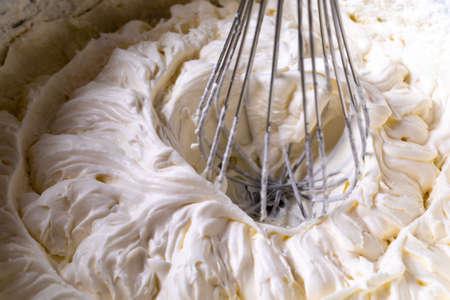 Cake cream. Whipped cream. Cream texture. Buttercream texture on top. Whipping the cream with a whisk. Making buttercream.
