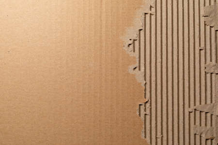 Texture of corrugated cardboard with torn edges. Texture cardboard packaging. Cardboard texture. Cardboard Mesh Background Stock Photo - 115741675