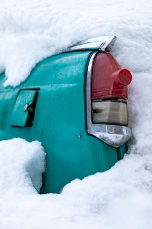 Russia, Moscow - January 31, 2019. Old Soviet car Volga. Turquoise retro car covered with snow. GAZ-21 on the street in winter.