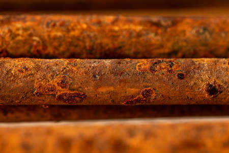 Scenic rusty fittings. Texture of rusty rods. Industrial abstraction. Rusty steel as a texture. Rust closeup