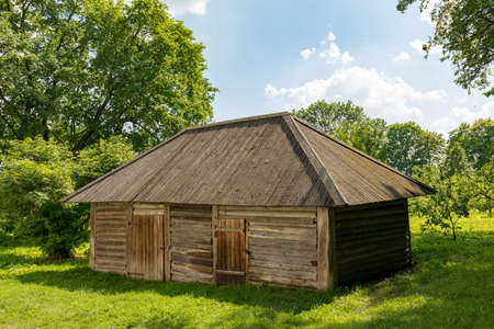 Old Russian rustic wooden shed. Wooden barn. Log shed.