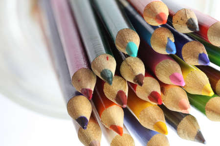 Colour pencils on white background close up photo