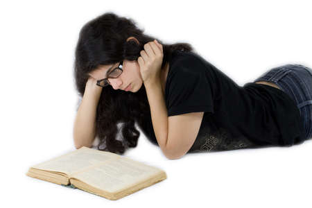 young girl laying reading the book Stock Photo - 15812054