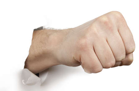inconvenience: Fist punching paper isolated on white background Stock Photo
