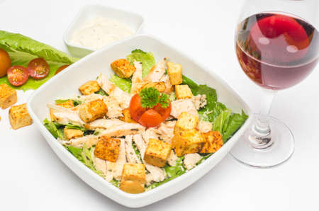 Chicken salad with caesar sauce and wine