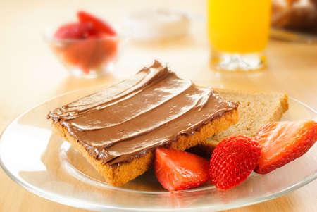 sandwich spread: Hazelnut chocolate spread over a slice of bread Stock Photo