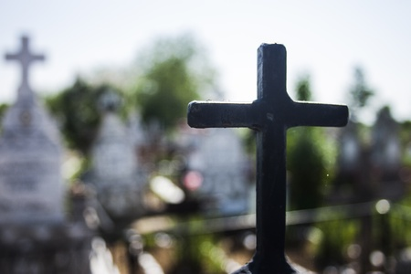 life after death: Black iron cross with white cross in background