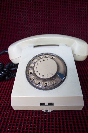 Traditional white rotary phone photo