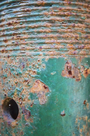 spall: Brown and green-blue rusty iron texture with a gap