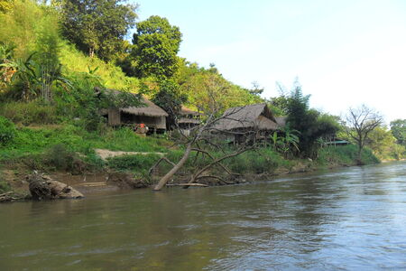 Real life in a small village of Thailand. Beautiful view on a river in big forest at northern of Thailand. photo