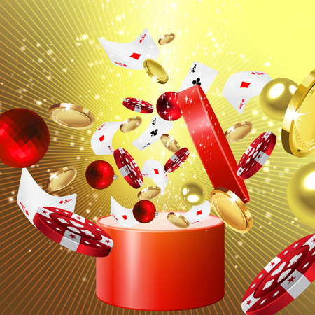 coming out: Christmas gift with glittering balls, casino  chips, cards and coins coming out of it Stock Photo