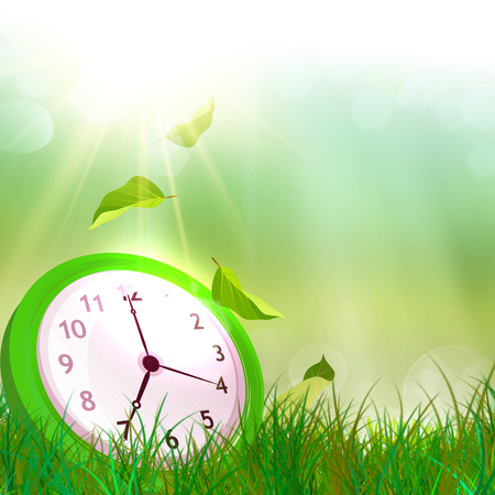 summer time: Time concept. Summer time. Alarm clock on the green grass Stock Photo