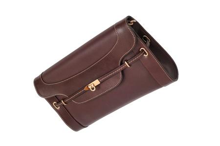dark red luxury female handbag with golden lock isolated on white background photo